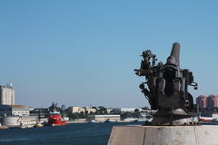 Cannon in Brindisi, with view of the port Stock Photo