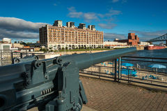 Cannon. Canon in Old Montreal port with a beach and bridge on a blue sky Stock Images