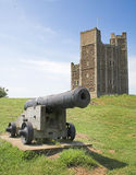 Cannon and castle. Cannon with the castle keep at orford suffolk UK royalty free stock image