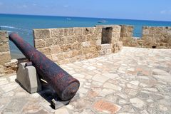 Cannon of a castle. A cannon of a castle with sea on the background Stock Photography