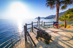Cannon on the coastline of Ligurian Sea. Italy Royalty Free Stock Photography