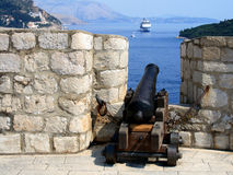 Cannon and cruise ship stock photography