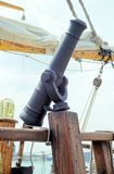 Cannon on the Deck. A antique cannon on the foredeck of a old sailing vessel Royalty Free Stock Photo