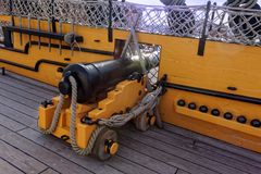 Cannon on Deck of Ship. A cannon on deck of HMS Victory in Portsmouth, England. HMS Victory is a 104-gun ship of the line of the Royal Navy, launched in 1765 stock images
