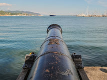 Cannon on the dock. An old cannon on the dock of the harbor in La Spezia (north Italy Royalty Free Stock Images