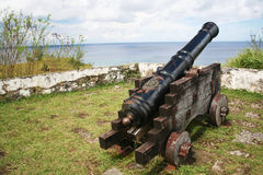 Cannon facing Pacific Ocean. Old Spanish cannon facing the Pacific Ocean in Umatac Bay, Guam Royalty Free Stock Image