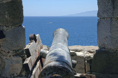 Cannon facing the sea. A medieval cannon faces out to sea between the turrets on Bodrum Castle in Turkey which dates back to the crusades Stock Photos