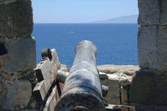 Cannon facing the sea Stock Photos