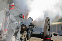 Cannon fire. Barrage during a US Civil War reenactment, as smoke fills the air Royalty Free Stock Image