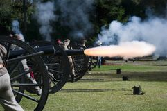 Cannon fire. Civil war reenactors fire a cannon at the enemy royalty free stock photo