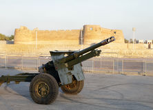 Cannon firing at Arad Fort for breaking the fast in the evening. MUHARRAQ, BAHRAIN-JULY 08: A cannon near the Arad Fort ready to fire at sunset as a signal to Royalty Free Stock Image
