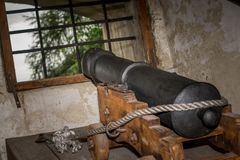 Cannon firing from castle. Cannon firing from medieval castle Stock Images
