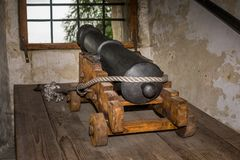 Cannon firing. From medieval castle Royalty Free Stock Images