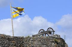 Cannon and flag on the ramparts Stock Photography
