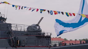 Cannon and Flag Ship of the Russian Navy. Ship's rate of gun against a background of waving signal flags stock video