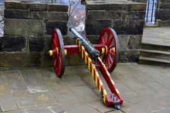 Cannon in front of the embrasure Stock Photo
