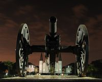 Cannon in front of Jackson Square. Night view of a cannon in front of Jackson Square and St. Louis Cathedral in New Orleans Stock Image