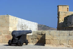 Cannon guard. An old cannon in a fortress in Gozo island Royalty Free Stock Photo