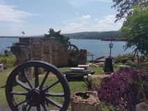 Cannon, landscape, tree, village, wheel, oxcart, lakeside, lakeshore. Cannon is landscape, wheel and ox. That marvel has tree, oxcart and horse cart, horse-cart stock photography