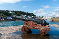Cannon at mouth of Porthleven harbour. stock photo