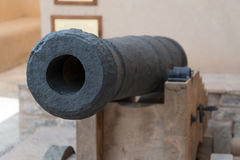 Cannon in Nizwa fort. An Old Cannon with portugal coat of arms, which protects Fort in Nizwa city, Oman stock photography