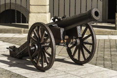 Cannon. Old cannon on the courtyard of Castle in Niepolomice near Krakow. Poland Royalty Free Stock Image