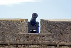 Cannon and old walls of a fort Royalty Free Stock Image