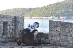 Cannon over harbor in Old Town Dubrovnik stock image