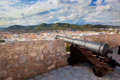 Cannon and panorama of Ibiza, Spain Stock Photos