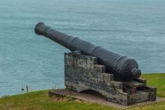 Cannon on Cliff as Sea Defense. A cannon pointing out over the sea Stock Image