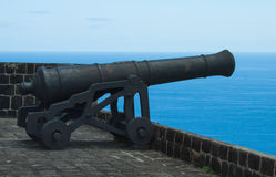 Cannon pointing out to sea on ramparts at Brimstone Fort, St. Kitts. April 26th,2013. Stock Photography