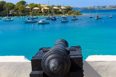 Cannon pointing at ships in the Caribbean Royalty Free Stock Photography
