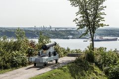 Cannon in Quebec City Canada plaines Abraham overlooking Saint Lawrence river and Jean-Gaulin Refinery in Levis town Royalty Free Stock Photography