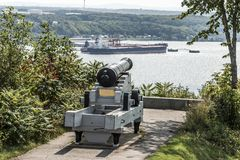 Cannon in Quebec City Canada plaines Abraham overlooking Saint Lawrence river and Jean-Gaulin Refinery in Levis town Royalty Free Stock Image