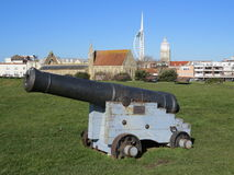 Cannon. On the seafront at Southsea, UK with the Garrison church and Spinnaker Tower in the background Stock Images