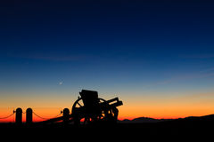 Cannon silhouette at twilight Stock Photos