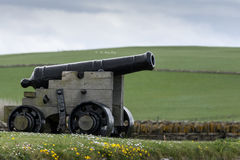 Cannon at Skara Brae Neolithic settlement. Royalty Free Stock Photos