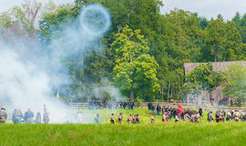 Cannon smoke. BATH, OH, USA - AUGUST 9, 2014: Artillery fire produces a giant smoke ring at a Civil War reenactment of the 3rd Battle of Winchester (1864) at Stock Photography