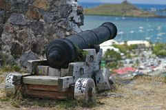 Cannon on St. Martin. An old historic cannon peers out over the harbor in St. Martin a tribute to days gone by stock photos