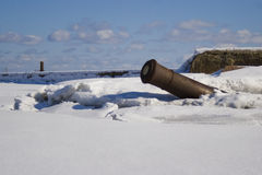 Cannon sticking out of snow Stock Image