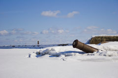 Cannon sticking out of snow Royalty Free Stock Image