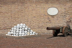 Cannon and stone cannonballs Stock Image