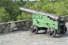 The cannon on the stone wall of the fortress Stock Photography