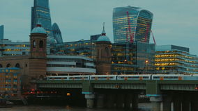 The Cannon Street Railway Bridge and the Financial District in London, England, UK stock footage