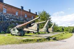 Cannon in Suomenlinna fortress area in Helsinki. Old cannons in Suomenlinna fortress area in Helsinki, Finland Stock Photo