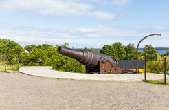 Cannon in Suomenlinna fortress area in Helsinki. Old cannon in Suomenlinna fortress area in Helsinki, Finland Royalty Free Stock Photos