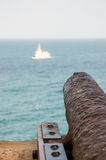 Cannon targeting a ship. Rusty cannon targeting a ship Stock Image