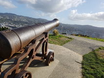 Cannon to the city. Cannon at the top of Mount Victoria in Wellington, NZ Stock Image