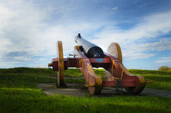 Cannon towards the sky. Old vintage cannon pointing towards the sky stock image