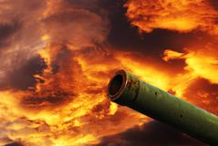 Cannon under cloudy red sky Stock Photos
